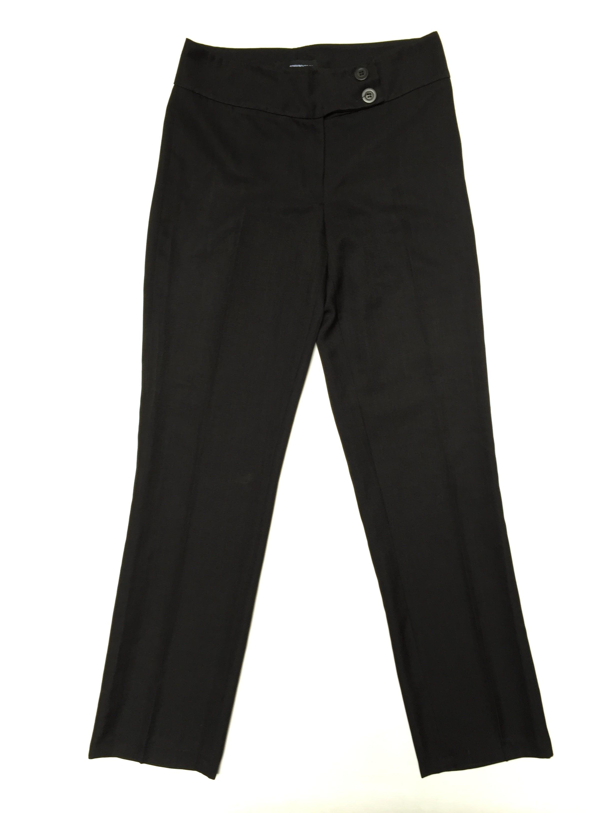 Pantalón gris tipo lanilla, a la cintura, forrado, corte recto, con doble botón en la pretina. Un básico! Talla 32