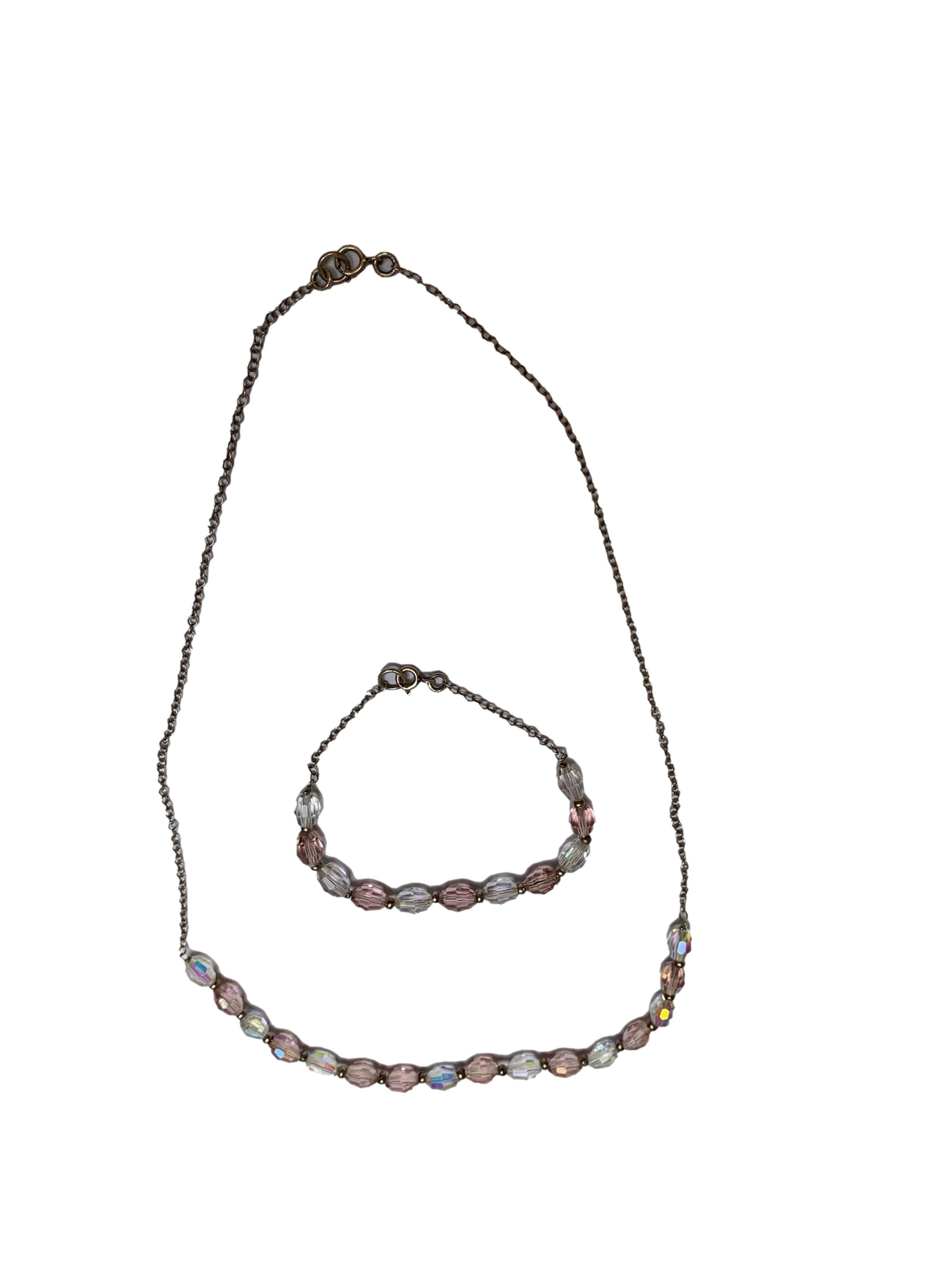 Conjunto: collar y pulsera plateados con mostacillas rosas y transparente. Largo 18cm y 50cm