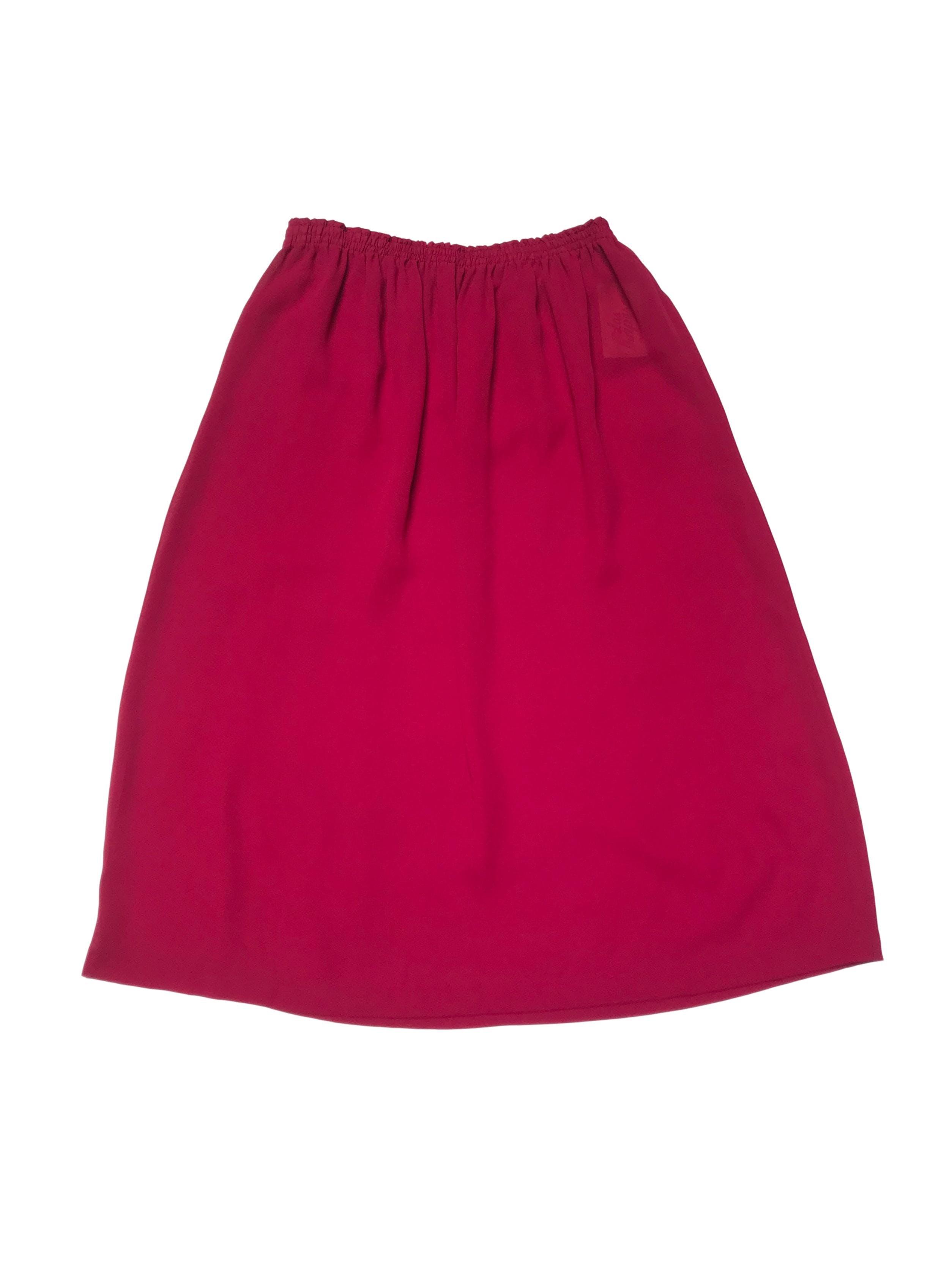 Falda de gasa guinda con elástico en la cintura. Úsala con forro