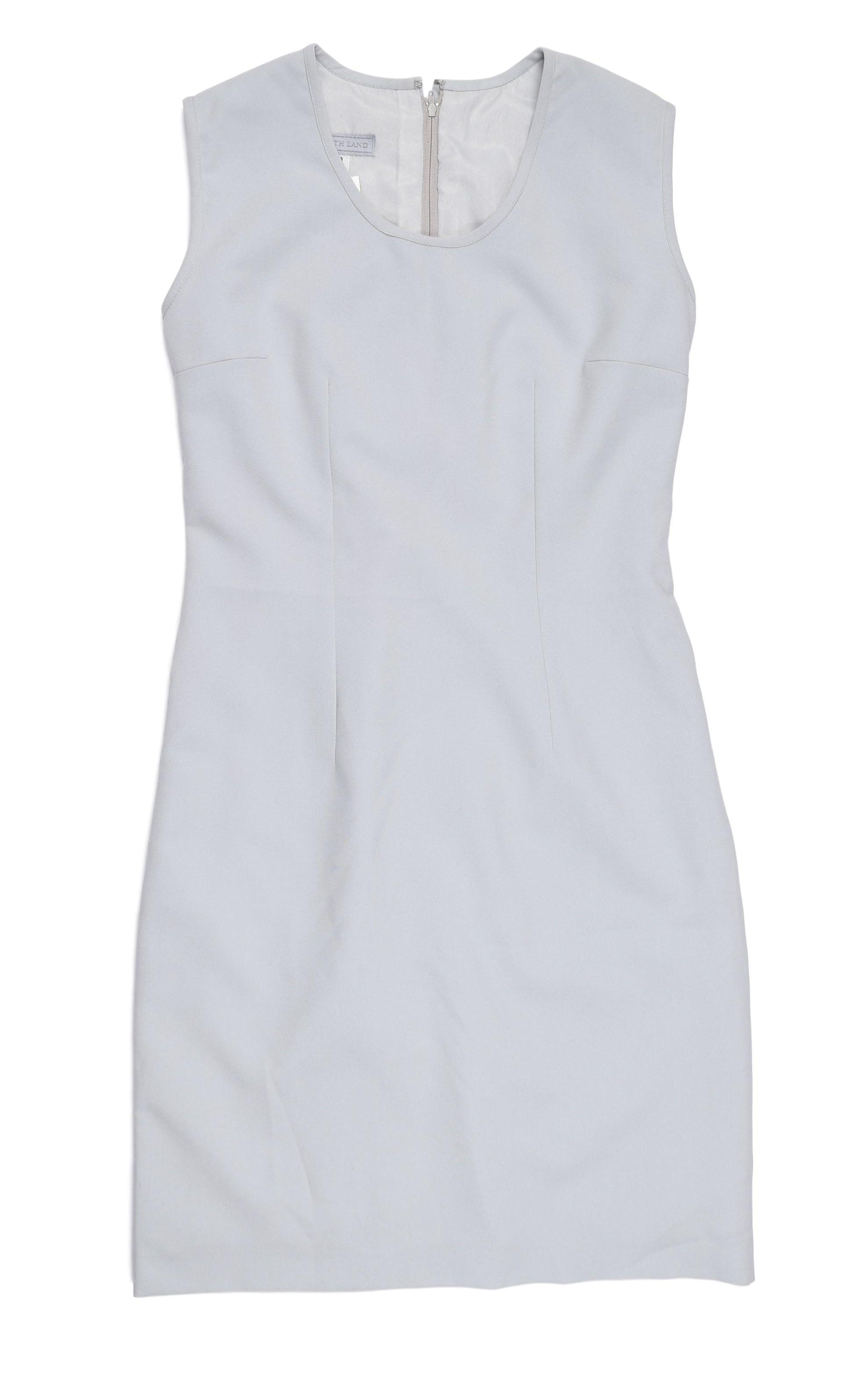 Vestido plomo corte recto, forrado, con cierre en la espalda. Busto 98 cm, cintura 78 cm, largo 92 cm