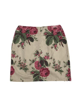Falda beige con estampado de rosas, cierre en la parte delantera y volantes. Pretina 68cm Largo 42cm foto 2