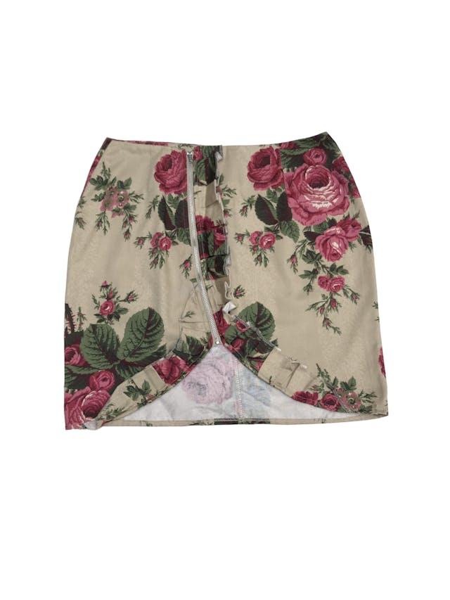 Falda beige con estampado de rosas, cierre en la parte delantera y volantes. Pretina 68cm Largo 42cm foto 1