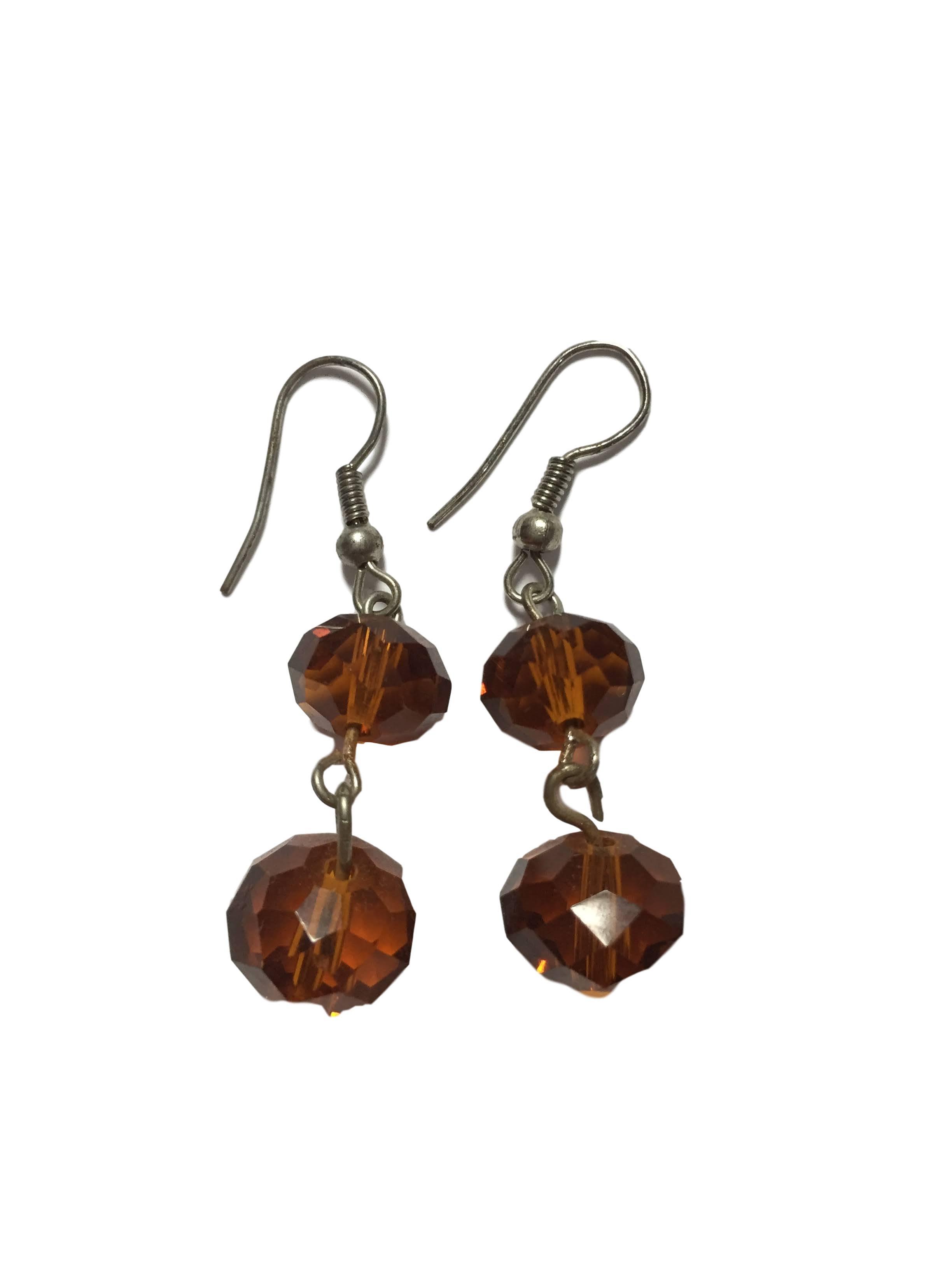 accesorios bijouterie aretes - dos piedras traslucidas marrones  - Talla u