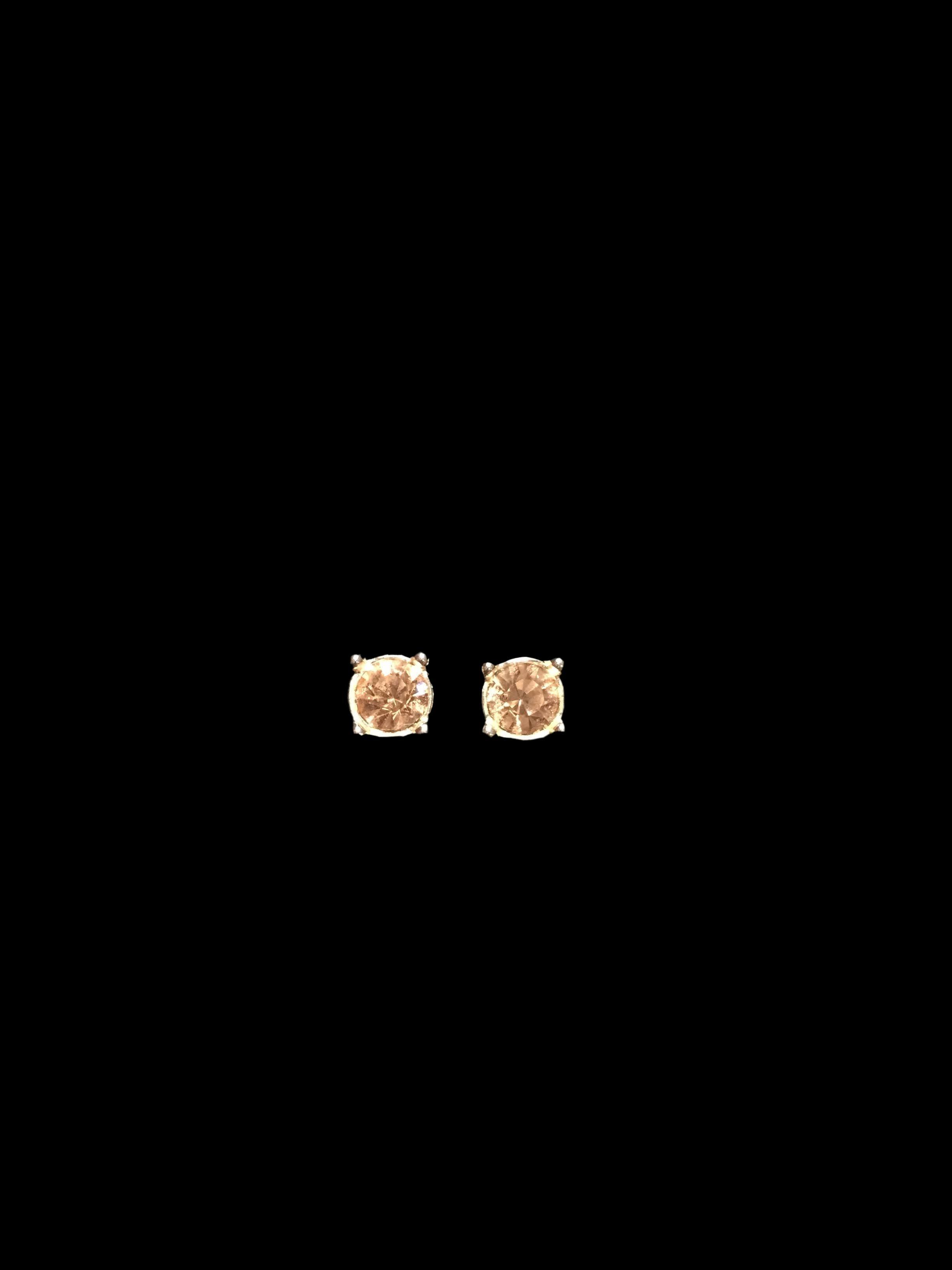 Aretes pegados plateados con incrustación tipo diamante