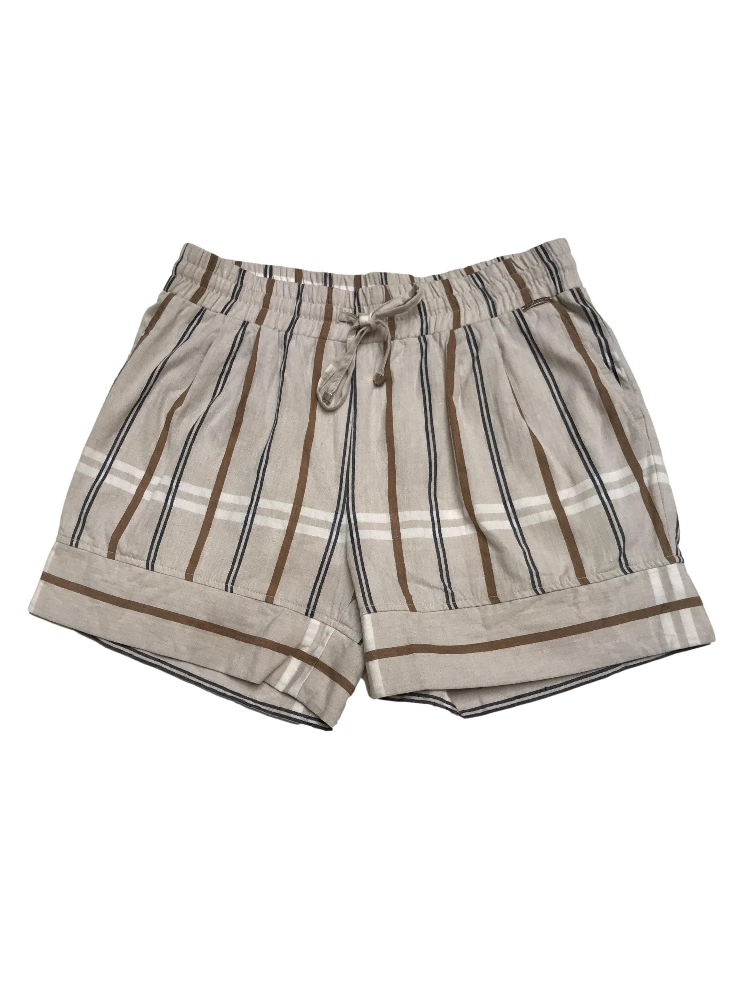 Short Michelle Belau crema con líneas marrones y azules, 54% lino 46% algodón, elástico en la cintura con pasador. Precio original S/ 170