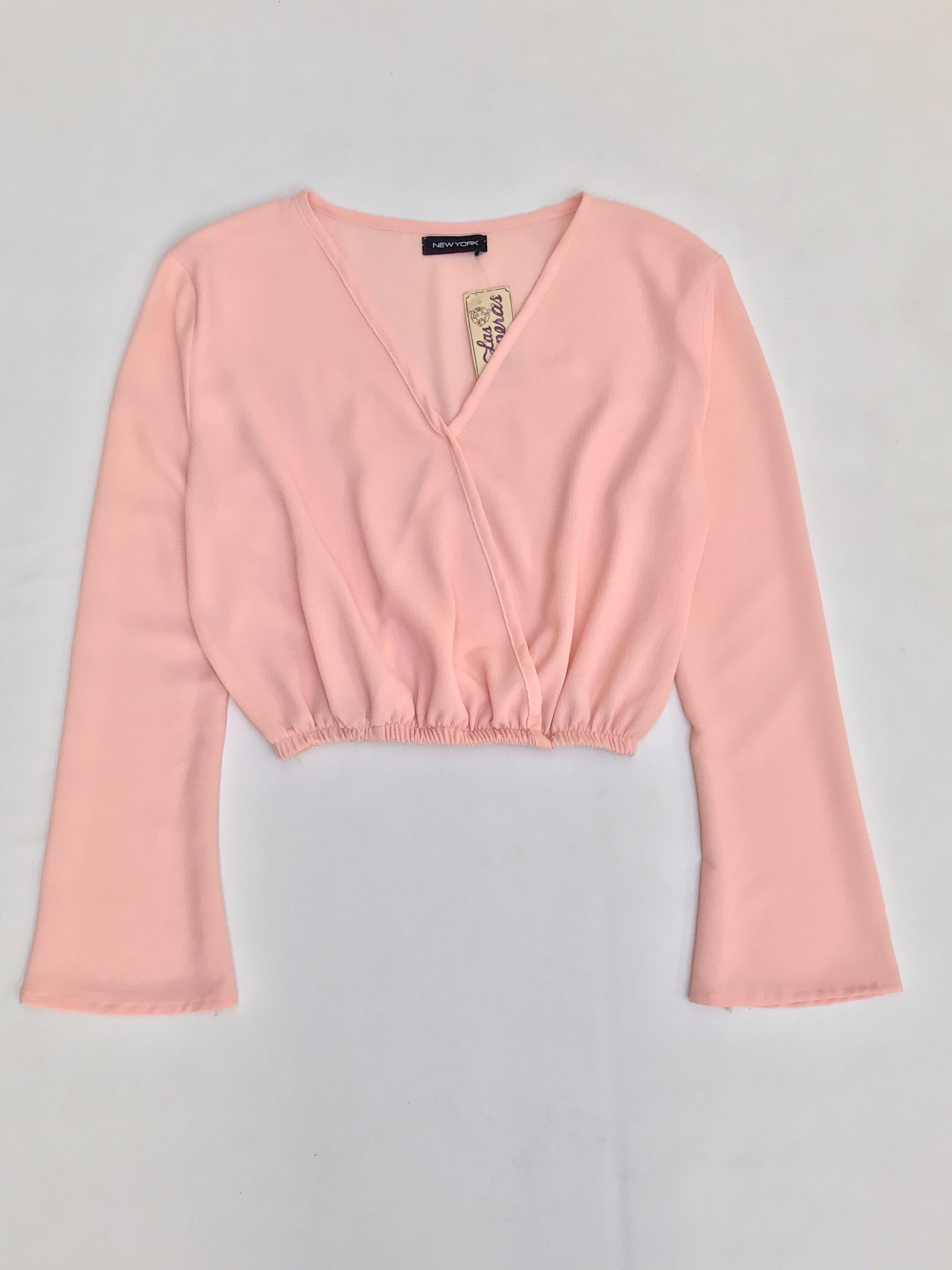 Blusa crepé rosa cruzado delantero y elástico en la basta