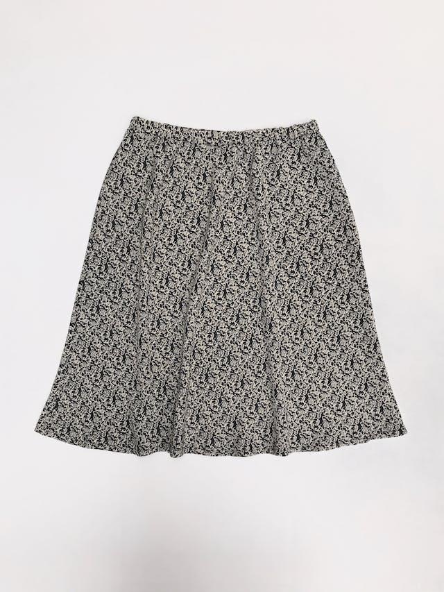 Falda negra con estampado beige, tela plana, elástico en la cintura y línea en A. Largo 60cm foto 1