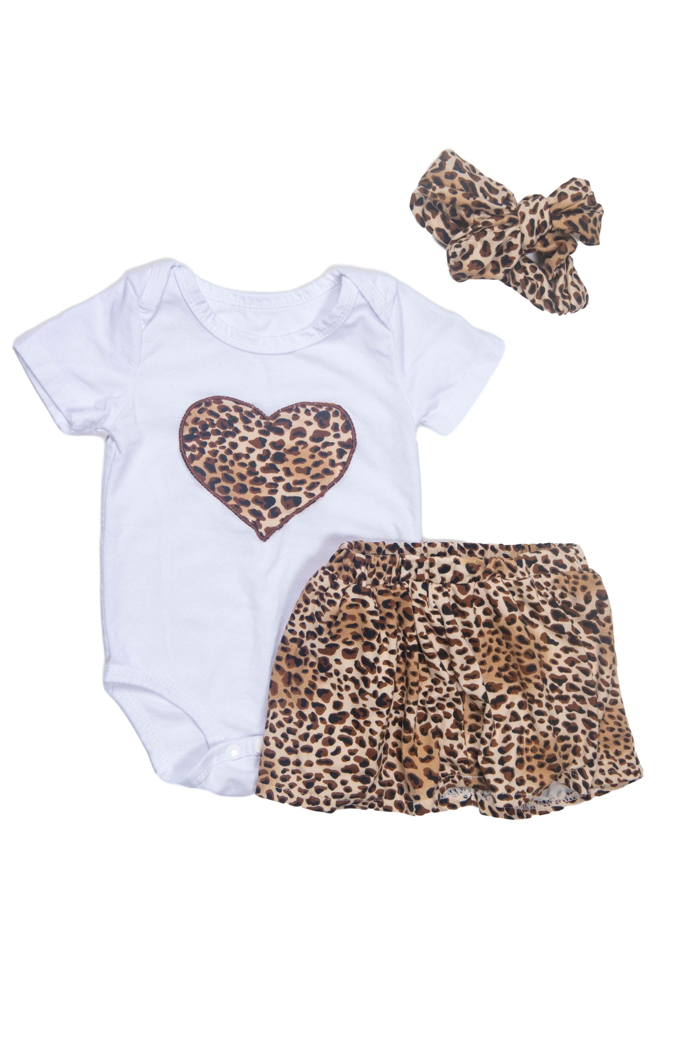 Body blanco con corazón animal print (8/10)y falda forrada animal print (10/10). Viene con vincha en juego. Todo 100% algodón. - Pat Pat