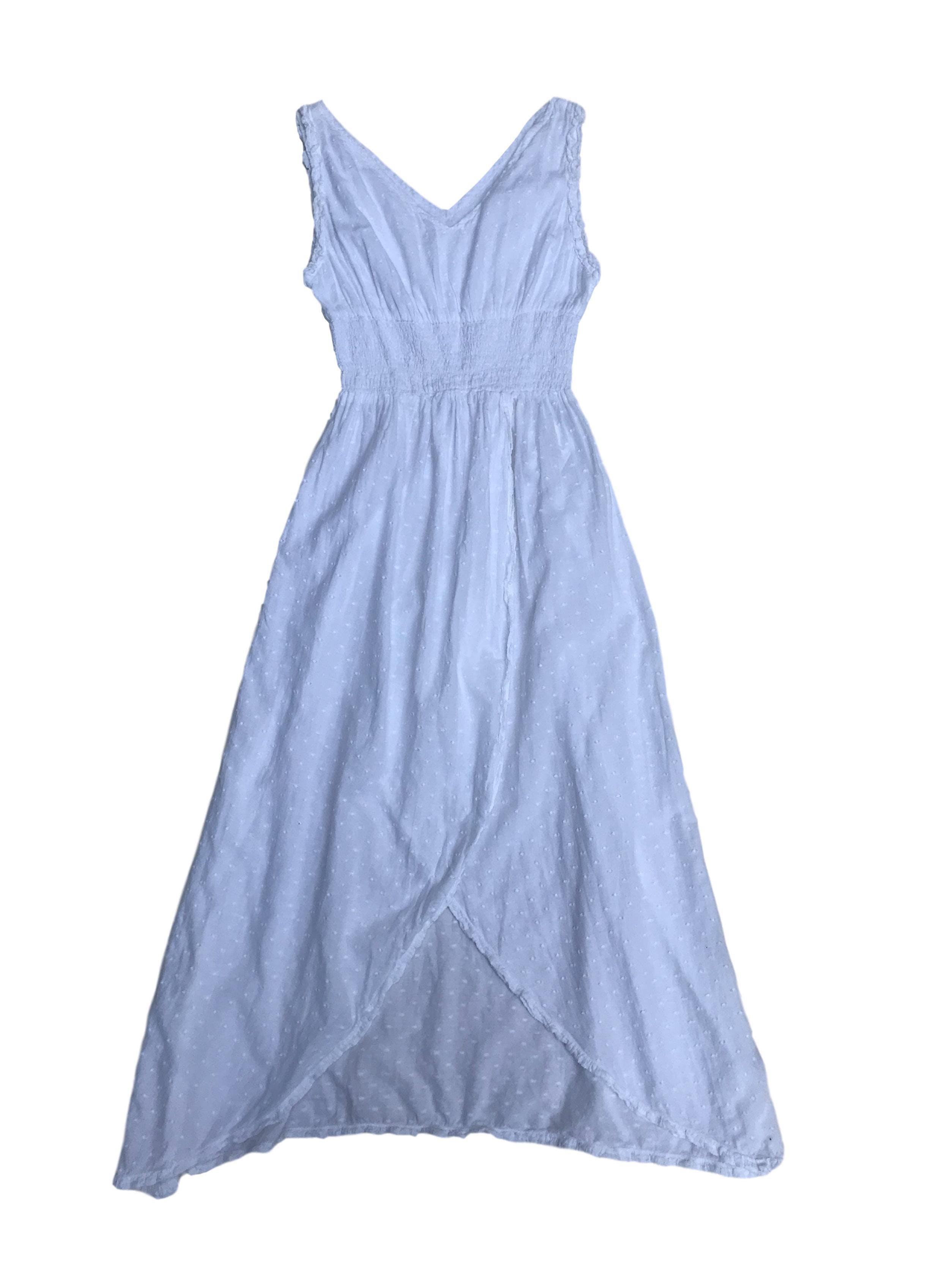 Vestido de algodón blanco con textura de puntos, panal de abeja en la cintura y falda cruzada. Largo 120cm