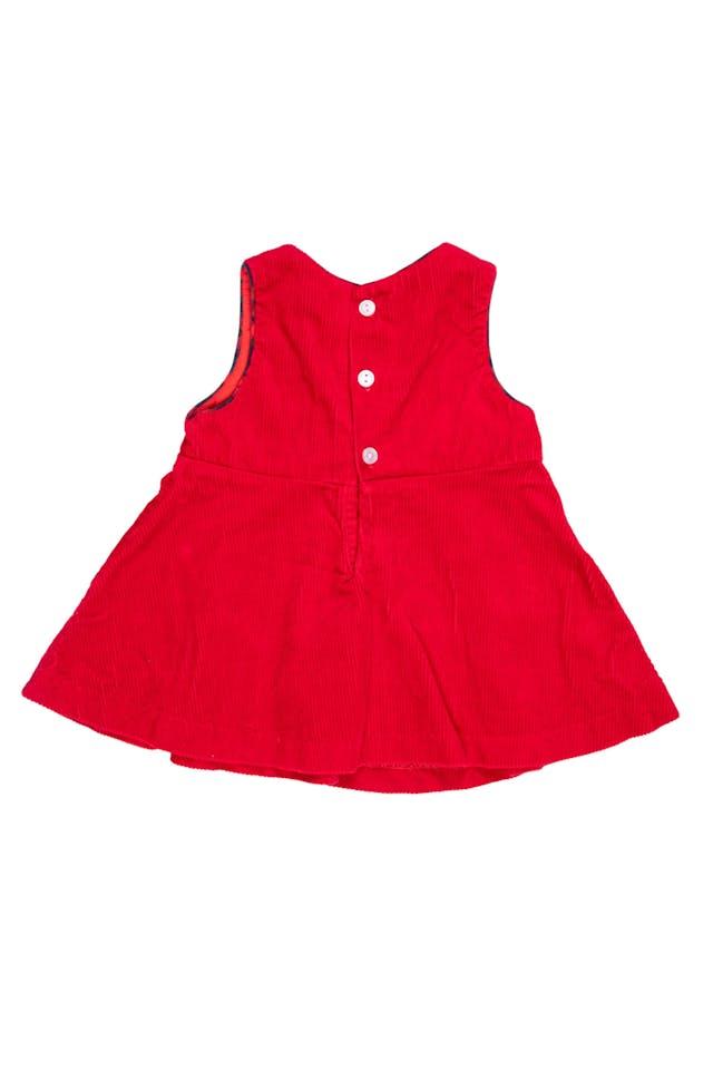 Vestido de corduroy rojo con ribetes y aplicaciones de manzanitas. 100% algodón foto 2