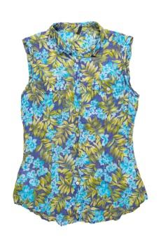 Blusa Benetton 100% algodón, azul con estampado de hojas y flores, pinzas, cuello camisero, botones nacarados y bolsillos en el pecho. Busto 90cm  foto 1