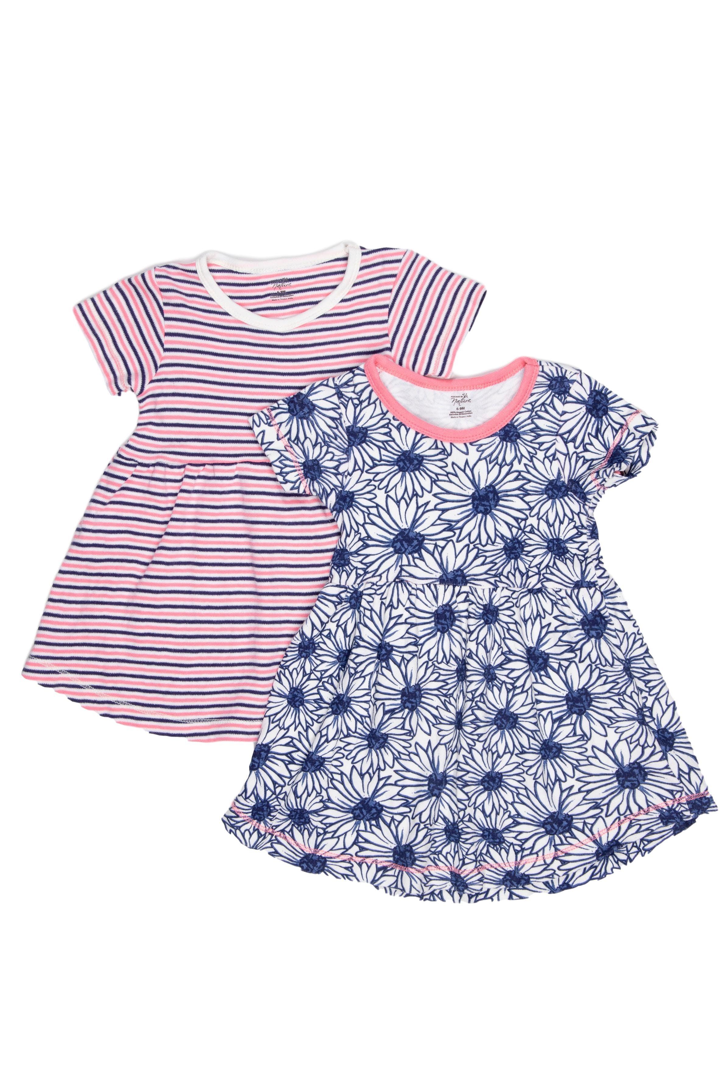 Pack de 2 vestidos. Uno a rayas rosado y azul otro con flores azules. Ambos 100% algodón orgánico. Dan opara usar con leggings hasta 12 meses - Touch By Nature