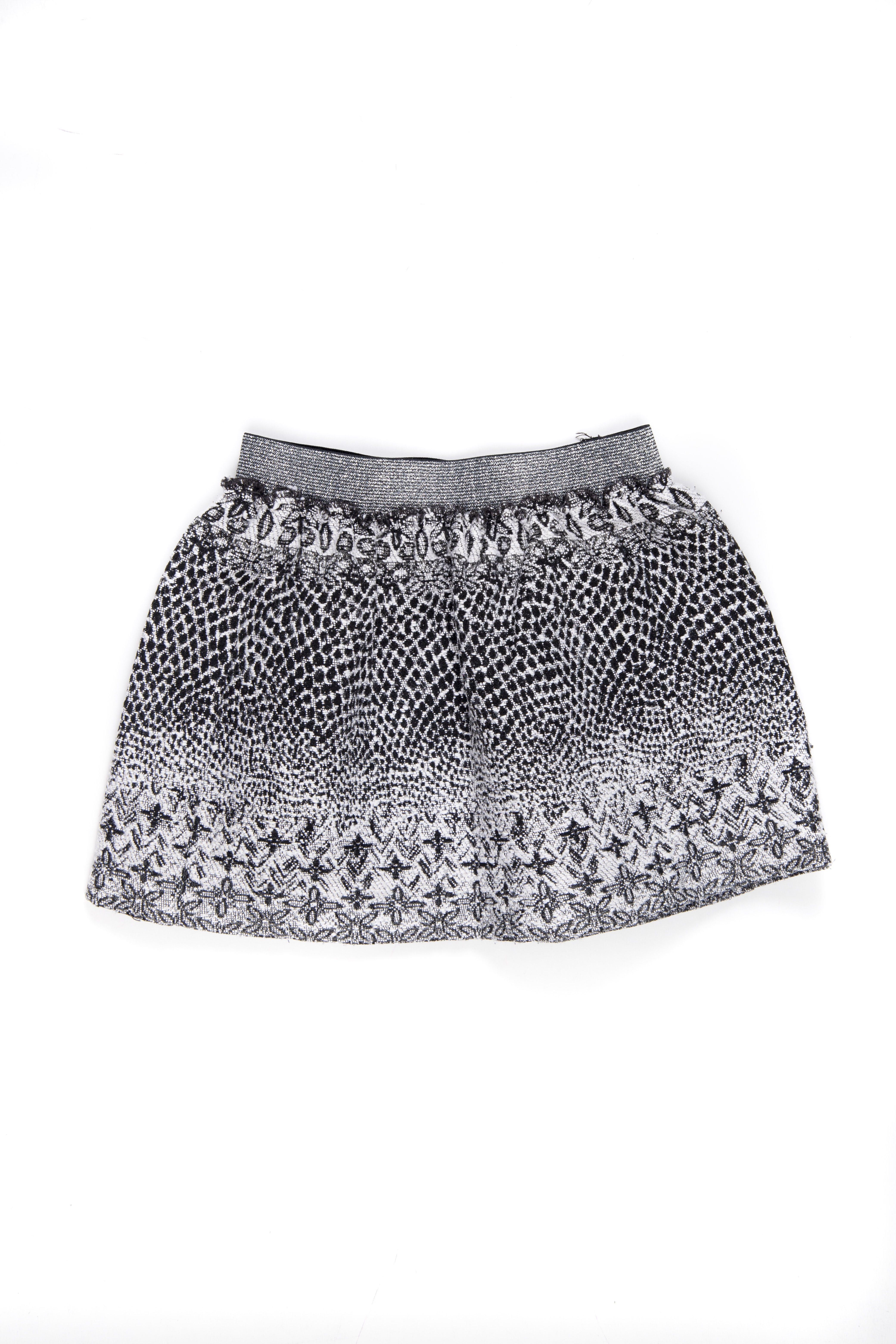 Falda de tela tipo gobelino estilo pollera. Tiene una anchita pero no se ve a simple vsita. - Zara