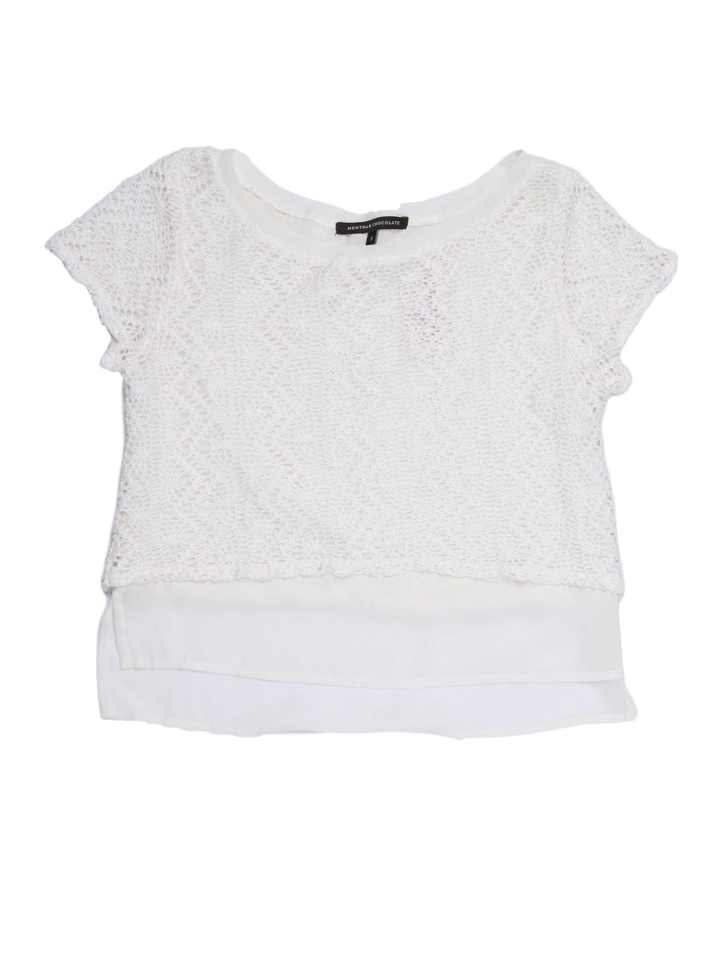Blusa corta Mentha&chocolate tipo tejida blanca con capa interior de gasa. Busto 90 cm. Precio original S/ 150