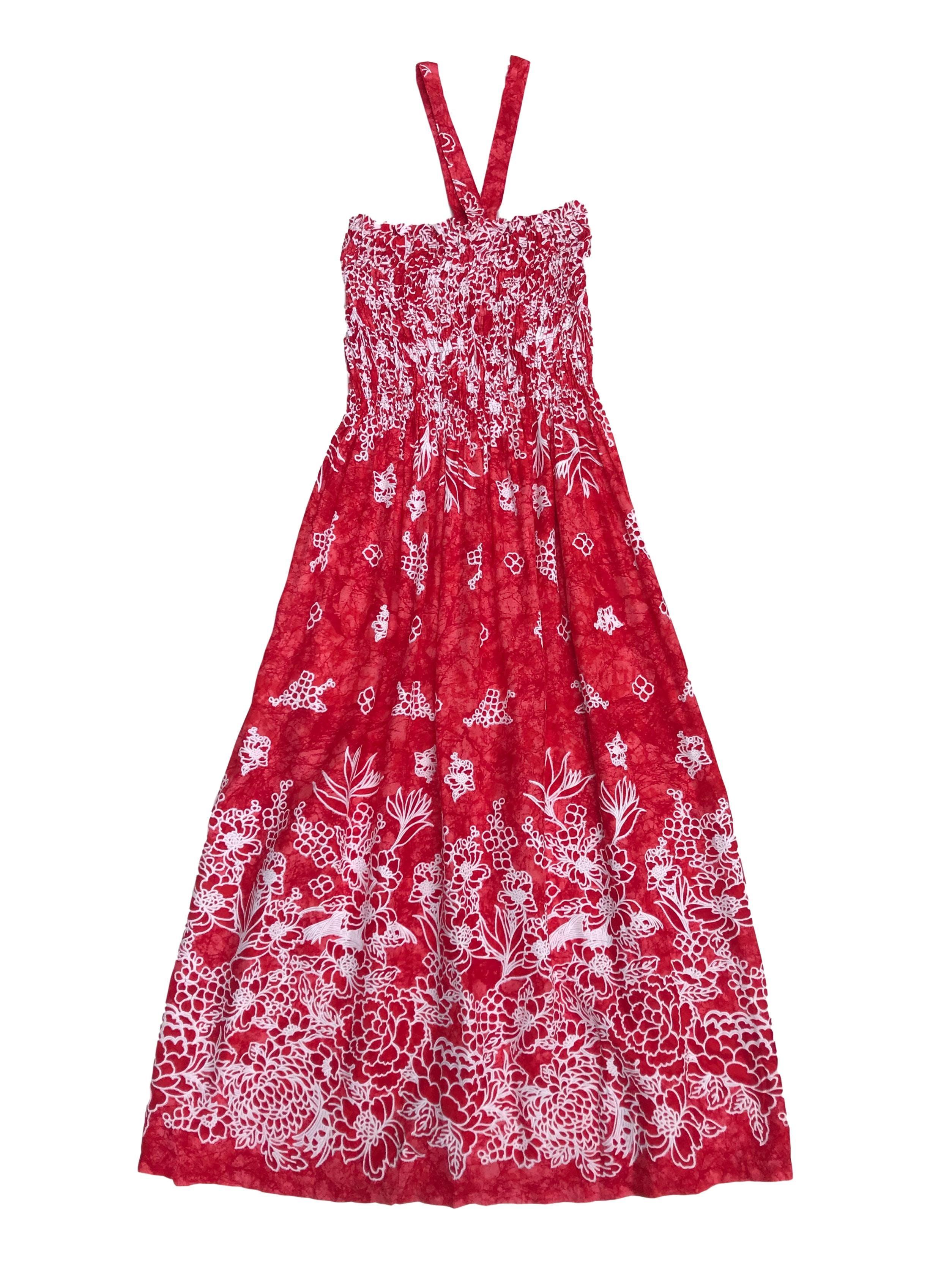 Vestido midi rojo con estampado blanco, cuello halter, panal de abeja en el top y falda con bolsillo. Largo 96cm