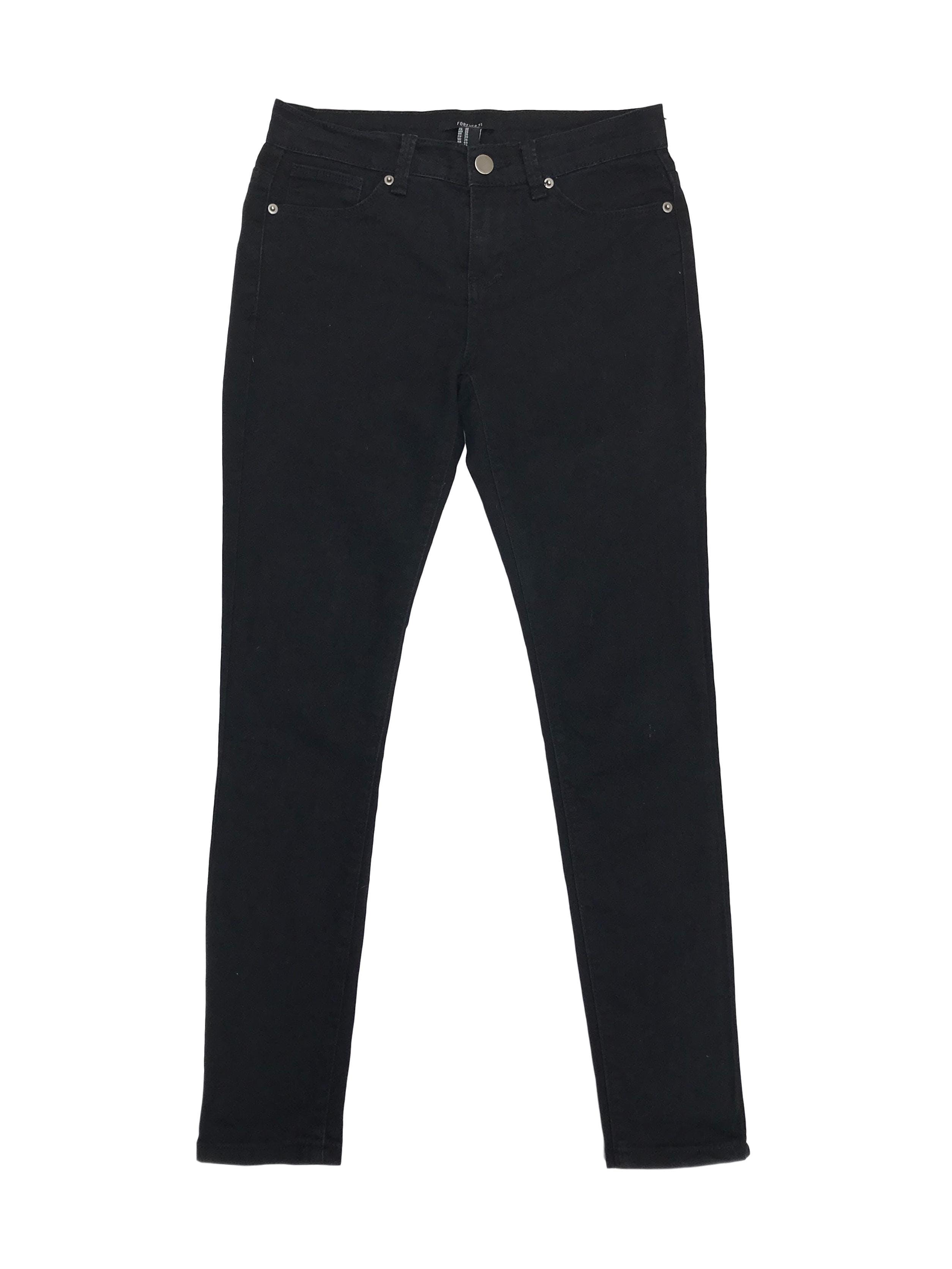 Pantalón jean pitillo Forever21 negro 61% algodón ligeramente stretch. Pretina 70cm