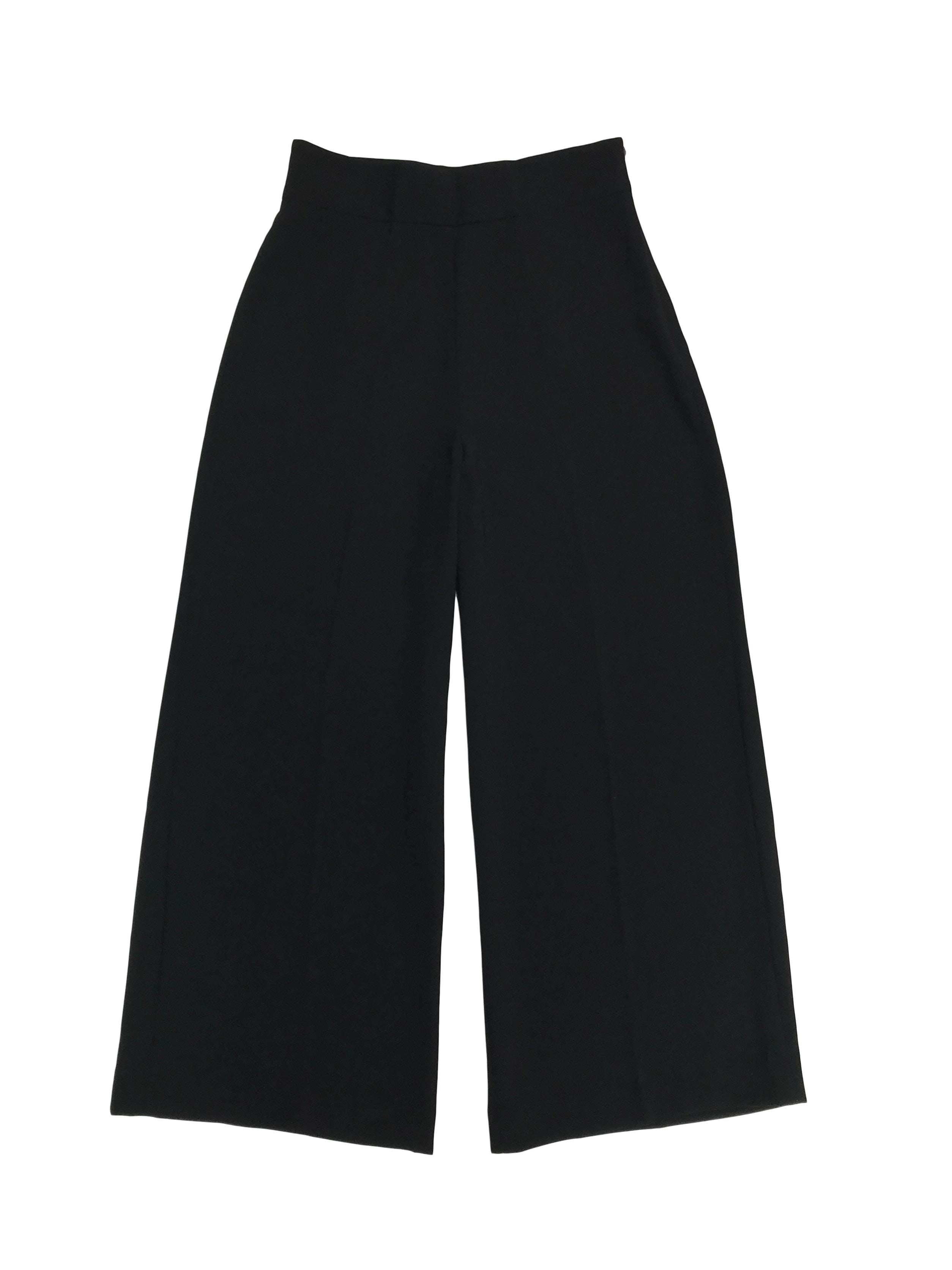 Pantalón palazzo Zara a la cintura, con cierre lateral, tela plana con caída. Cintura 72cm