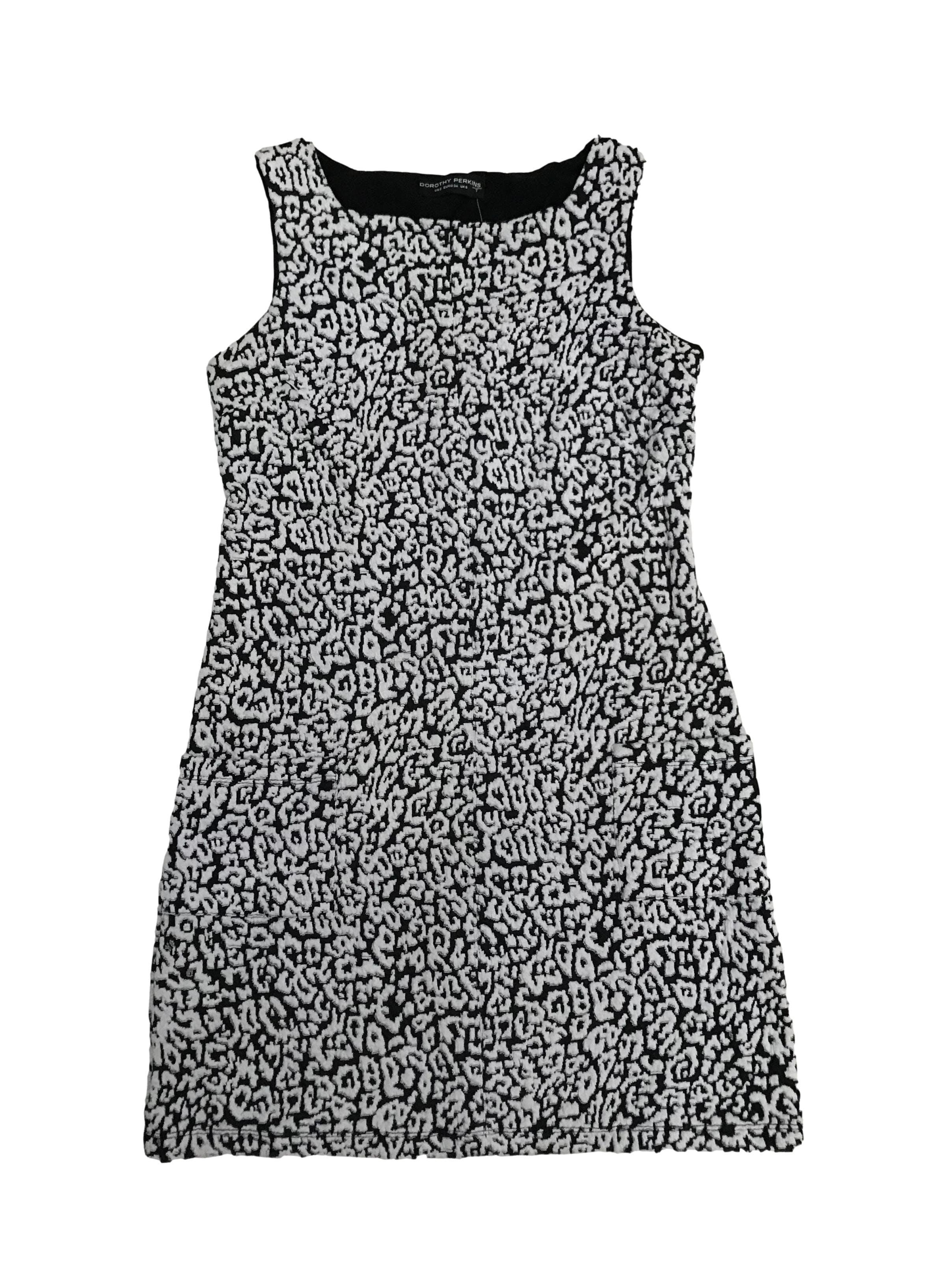 Vestido Dorothy Perkins negro con texturas blancas en relieve, bolsillos en la falda, es stretch. Largo 80cm