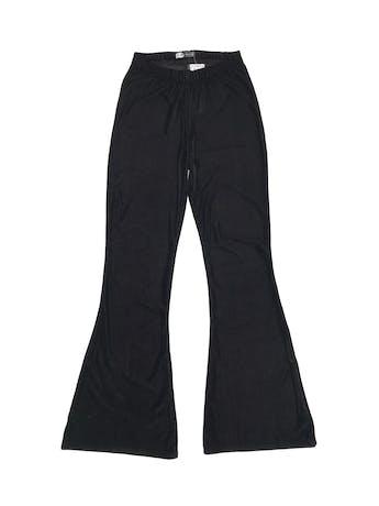 Pantalón tipo corduroy satinado negro, a la cintura, pegado al cuerpo con basta campana. Cintura 60cm (sin estirar). Nuevo con etiqueta, precio original S/ 89.9 foto 1