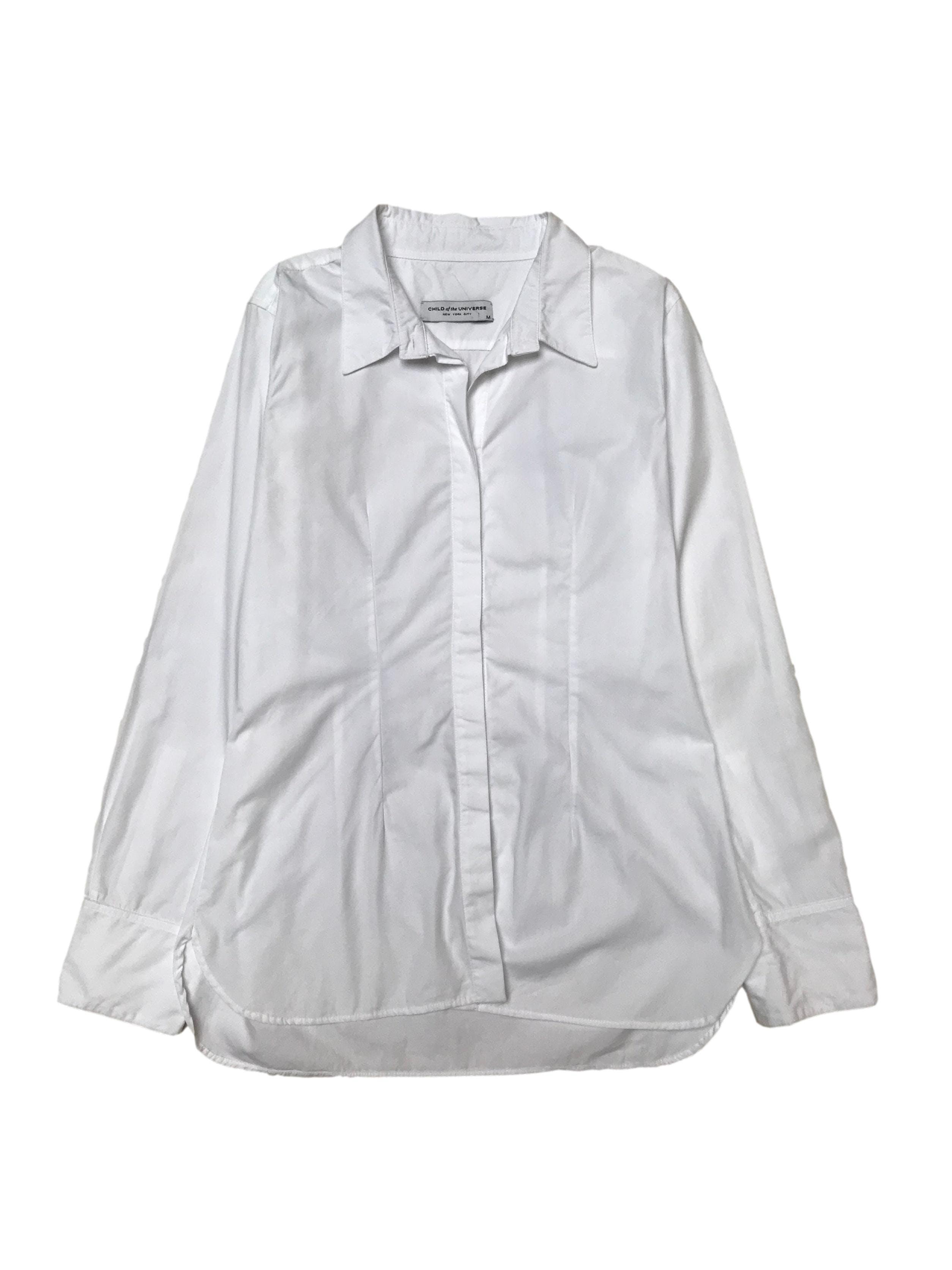 Blusa Child of the Universe 100% algodón blanco, con pinzas (Busto 100cm). Clásica y básica de todo closet. Precio original S/ 390