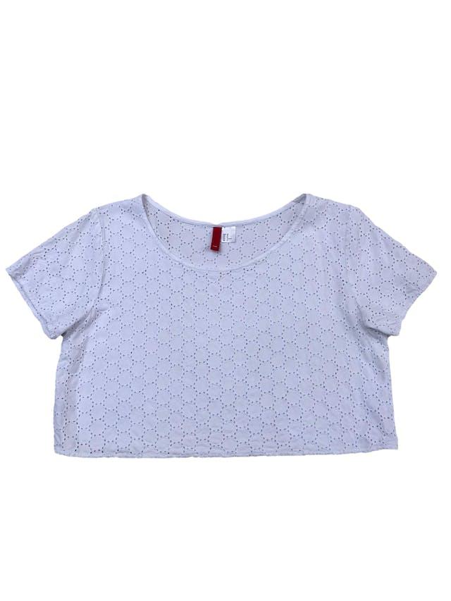 Blusa crop H&M blanca de algodón con textura en círculos y detalles calados. Largo 40cm foto 1