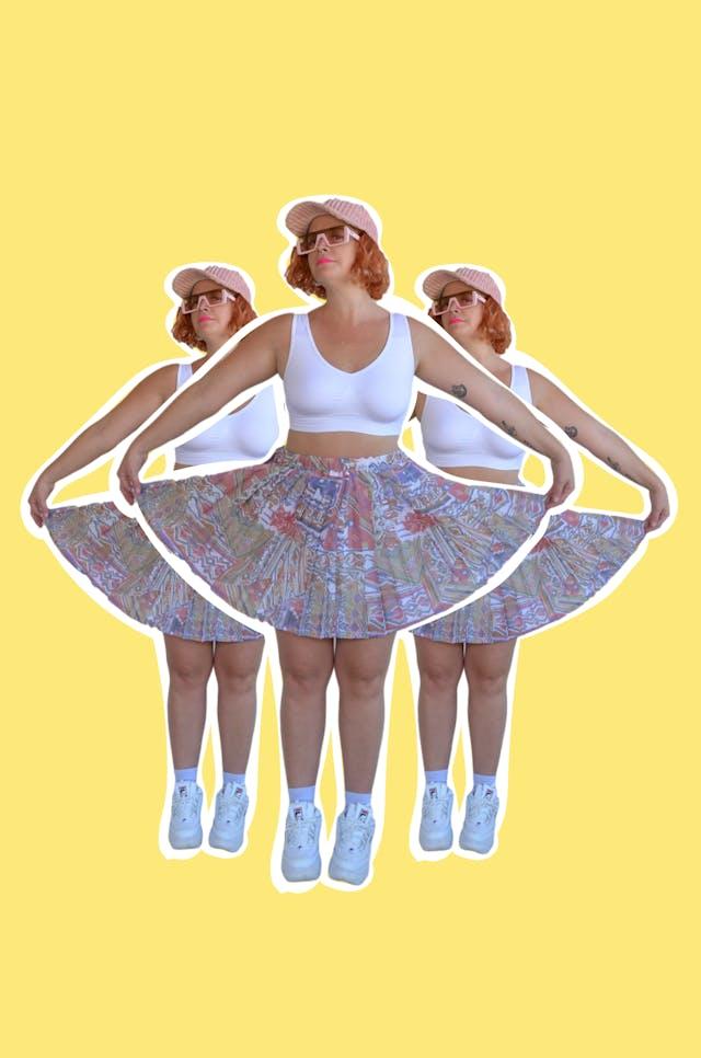 Falda vintage de gasa plisada con estampado geométrico, lleva forro y pretina elástica. Pretina 78cm si estirar Largo 45 cm foto 1