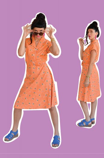Vestido vintage 100% algodón con print de flores estilo acuarela, botones en el pecho, cierre lateral y con correa. Largo 105cm foto 1