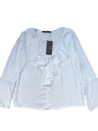 Blusa Topitop de gasa blanca, escote en V con volante y botones, manga larga con puño campana. Busto 100cm  Largo 58cm. Nueva con etiqueta foto 1