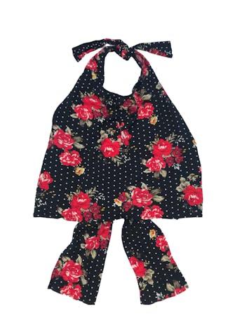 Blusa halter que se amarra en cuello y espalda, de rayón negro con print de lunares blancos y flores foto 1