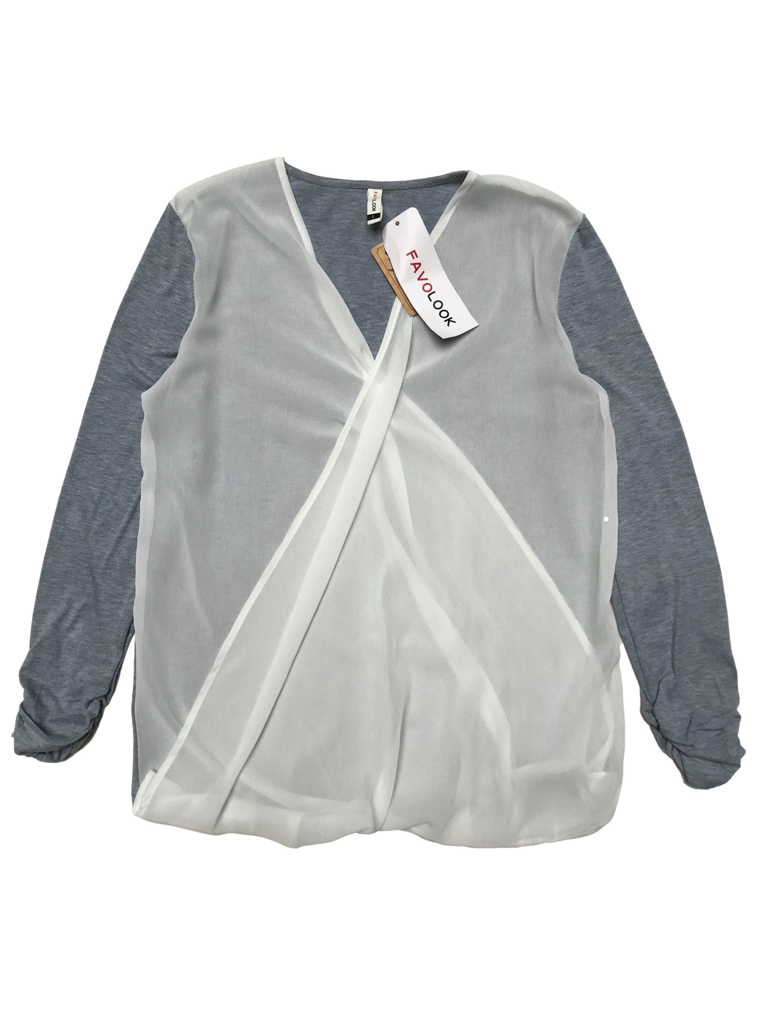 Blusa de tela tipo polo stretch con delantero de gasa cruzada, manga 7/8 con dreapeado. Busto 98cm Largo 60cm. Nuevo con etiqueta.