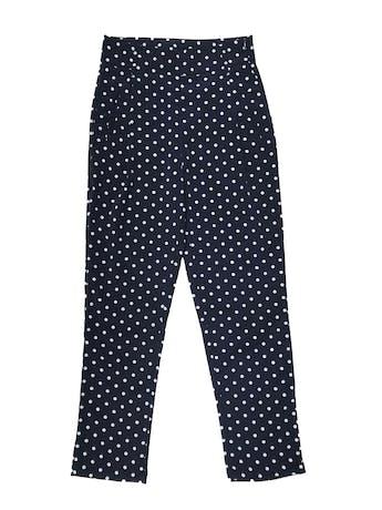 Pantalón Moixx a la cintura, azul con lunares blancos, con bolsillos laterales y cierre al lado, tela plana delgada. Cintura 70cm Largo 100cm. Precio original s/ 149 foto 1