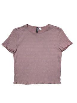 Polo H&M palo rosa con textura corrugada stretch. Largo 40cm foto 1