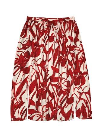 Falda midi Mango con aberturas laterales, fondo crema con estampado de hojas. Cintura 66 cm. Largo 70 cm.  foto 1