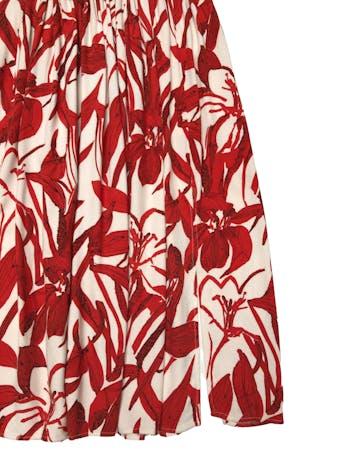 Falda midi Mango con aberturas laterales, fondo crema con estampado de hojas. Cintura 66 cm. Largo 70 cm.  foto 2