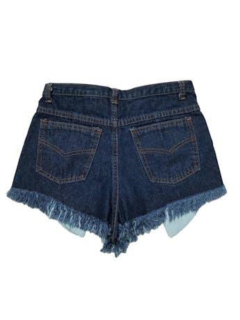Short jean a la cintura, rasgado con bolsillos delanteros largos.  Cintura 68cm. Largo 25 cm.  foto 2